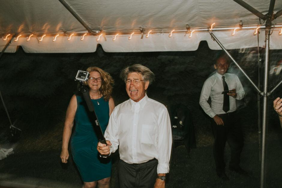 dad using gopro at wedding