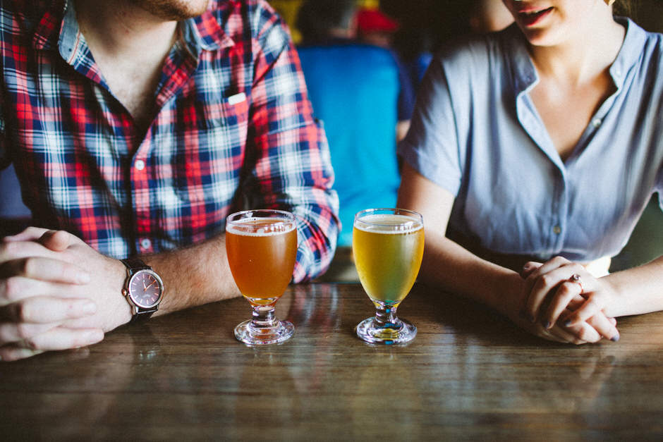 couple on date with beers at batch brewing company