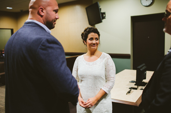 bride and groom listening to judge