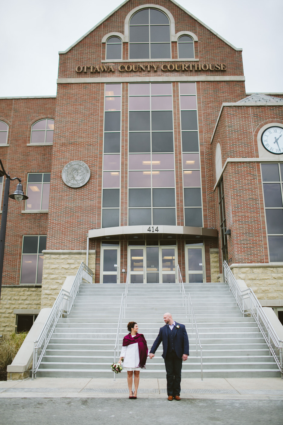 couple outside of ottawa county courthouse grand haven