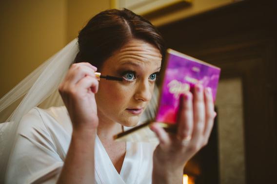 bride putting on mascara