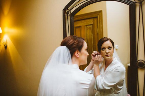 bride getting earrings on