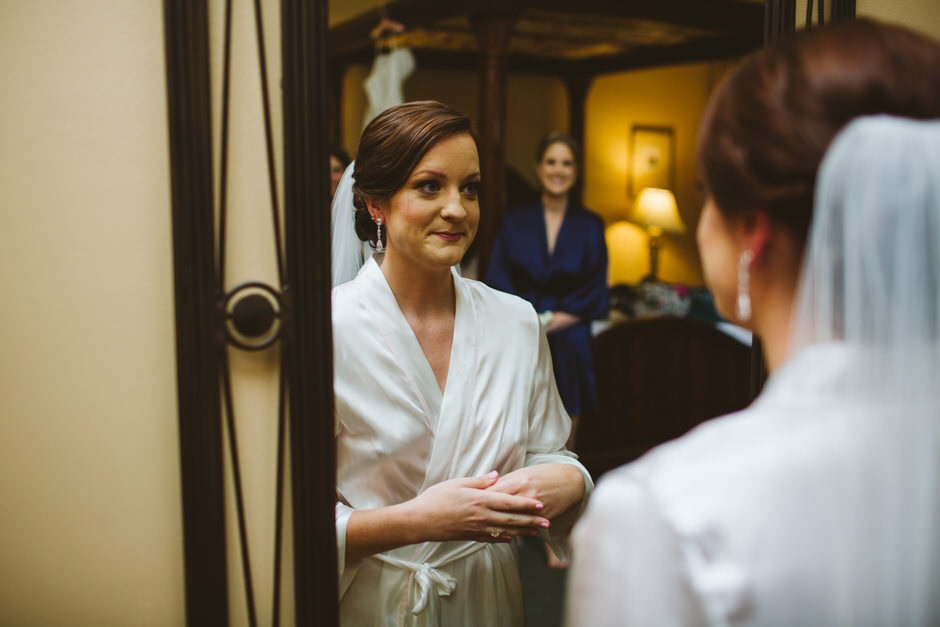 friend looking at bride in mirror
