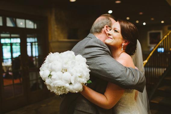 bride and dad hugging