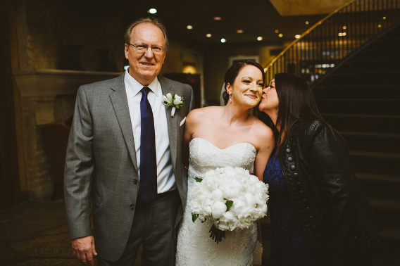 family photo mom kissing bride